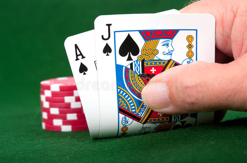 how much can you make playing blackjack. A player showing a 21 with ace and jack.